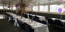 Golden Jubilee's lower saloon set up for a sit down meal